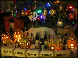 monorail playset and dept 56 disney heritage village under the christmas tree