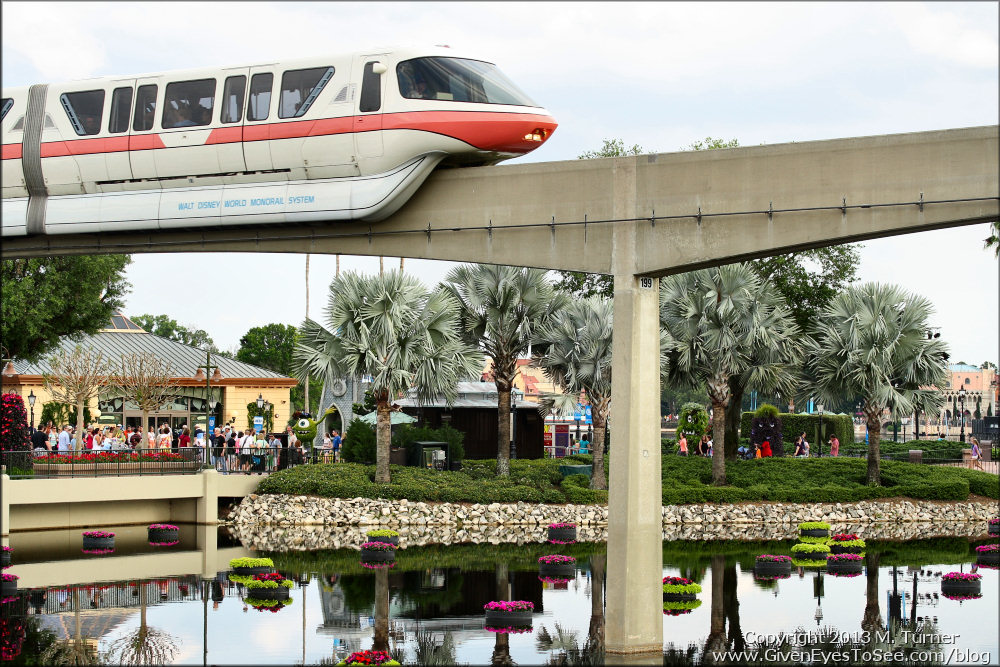 Monorail goes by gardens during the Flower and Garden Festival at Epcot
