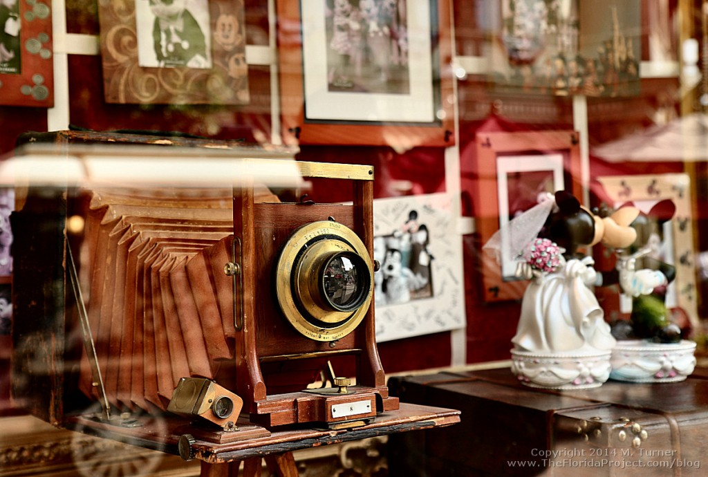 Vintage antique old time camera and picture frame on display in a main street shop window. Magic Kingdom, walt disney world (WDW) orlando florida