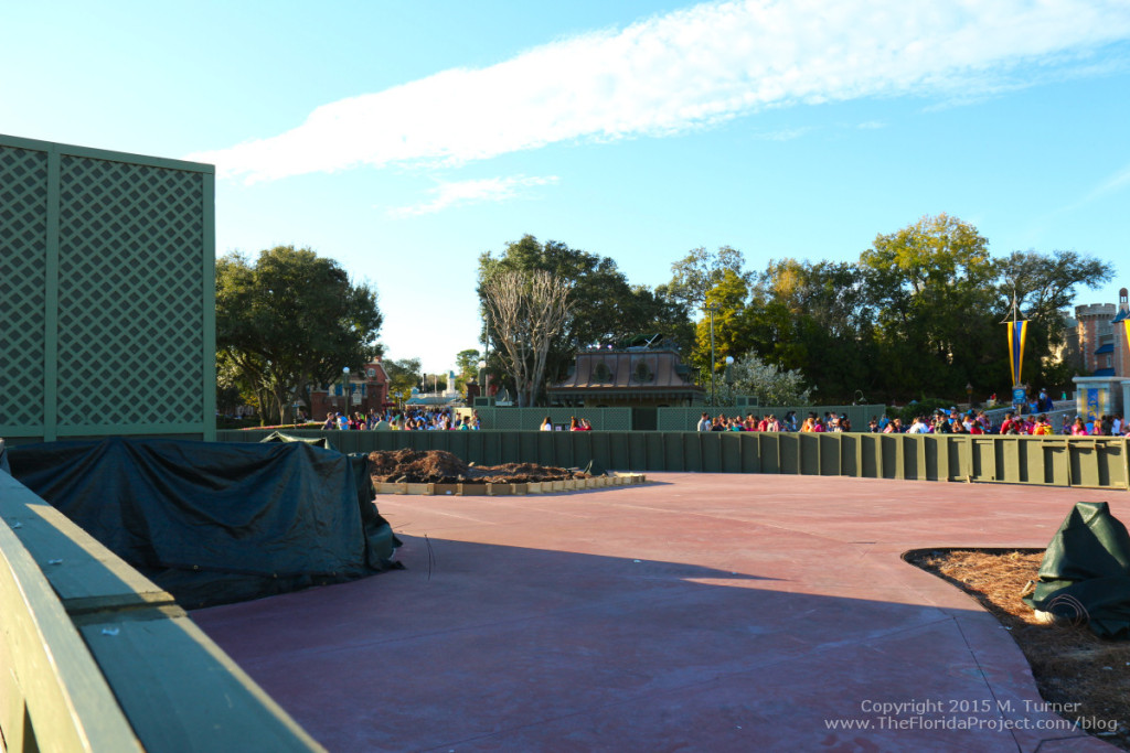 Facing Cinderella Castle, looking left towards Liberty Square bridge from center Hub wall.