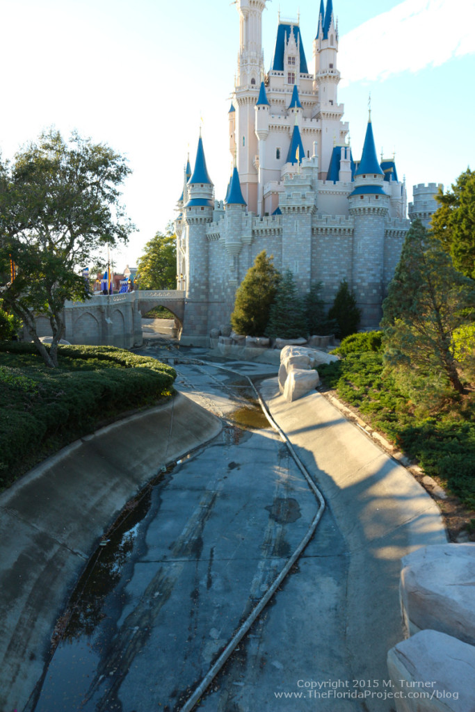 The moat surrounding Cinderella Castle was completely drained, revealing concrete and tracks leftover from the Swan Boats.