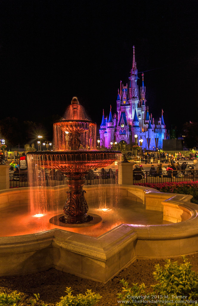 water fountain in garden fp+ viewing area in the expanded hub of magic kingdom cinderella castle background walt disney world wdw