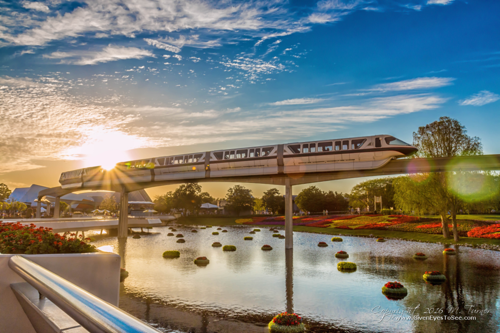 The WDW Monorail chases the sunset as it goes through Epcot during the Flower and Garden Festival, April 2016 by Miss M. Turner